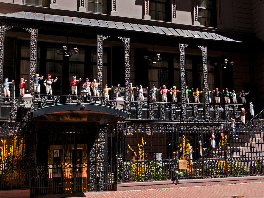 21 Club, restaurant and former prohibition-era speakeasy, painted cast iron lawn jockey statues, 21 West 52nd Street, Manhattan, New York City, New York, USA
